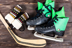 Overhead view of hockey ice skates accessories placed on old rus Royalty Free Stock Photography