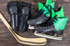 Overhead view of hockey ice skates accessories placed on old rus Royalty Free Stock Photos