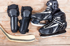 Overhead view of hockey ice skates accessories placed on old rus Royalty Free Stock Image