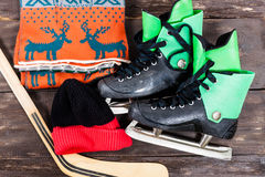 Overhead view of hockey ice skates accessories placed on old rus Stock Image