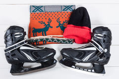 Overhead view of hockey ice skates accessories placed on old whi Stock Image