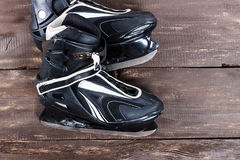 Overhead view of hockey ice skates on old rustic wooden table. Royalty Free Stock Image