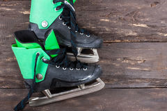 Overhead view of hockey ice skates on old rustic wooden table. Stock Photos
