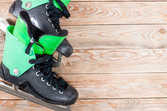 Overhead view of hockey ice skates on old rustic wooden table. Stock Photo