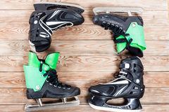 Overhead view of hockey ice skates on old rustic wooden table. Royalty Free Stock Photography