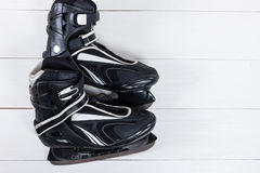 Overhead view of hockey ice skates on white wooden table. Stock Image