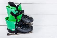 Overhead view of hockey ice skates on white wooden table. Stock Photo