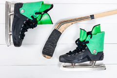 Overhead view of hockey stick and ice skates on old rustic woode Stock Image