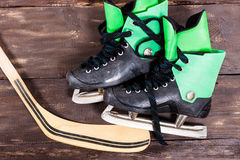 Overhead view of hockey stick and ice skates on old rustic woode Royalty Free Stock Image