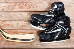 Overhead view of hockey stick and ice skates on old rustic woode Royalty Free Stock Photos