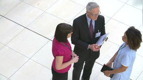 Overhead View Of Hospital Staff Meeting In Busy Reception stock footage