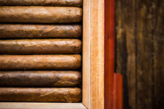 Overhead view on humidor with cigars Royalty Free Stock Photography