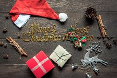 Overhead view of image decorations & ornaments merry Christmas & Happy new year background concept. All accessories on vintage rustic brown wooden at home Stock Image