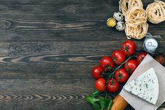 Overhead view of ingredients for an Italian pasta recipe on rust. Ic wood boards with copyspace Royalty Free Stock Image