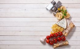 Overhead view of ingredients for an Italian pasta recipe on rust. Ic wood boards with copyspace Stock Images