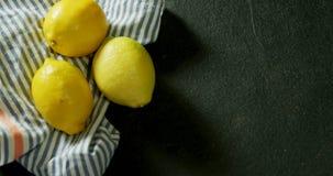Lemon with a cloth on black background 4k. Overhead view of lemon with a cloth on black background 4k stock video footage