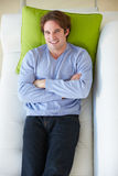 Overhead View Of Man Relaxing On Sofa. Smiling To Camera royalty free stock photo