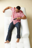 Overhead View Of Man Relaxing On Sofa Stock Photography