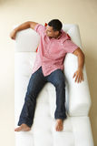 Overhead View Of Man Relaxing On Sofa Royalty Free Stock Images
