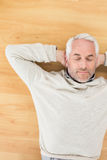 Overhead view of a man sleeping on parquet floor Royalty Free Stock Photos