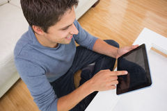 Overhead view of man using digital tablet in living room Stock Photography