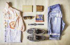 Overhead view of men's casual outfits on brown paper. Overhead view of men's casual outfits on brown paper background Royalty Free Stock Photography