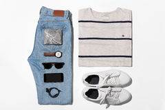Overhead view of men's casual outfits, Outfits of traveler, male. Man's clothing ( T-shirt,jean,wallet,watch,sunglasses,phone,earphone shoe Stock Photo