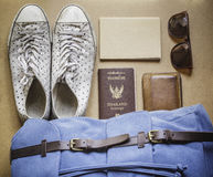 Overhead view of men's casual outfits on wood board. Background Stock Photography