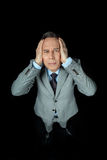 Overhead view of middle aged frightened businessman in suit Royalty Free Stock Photos