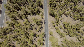Overhead view of mountain road across forest Stock Photo