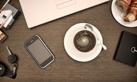 Overhead view of a notebook computer, fresh croissants and a whi. Te cup of coffee on a rustic wooden cafe table Stock Photography