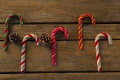 Free Overhead View Of Colorful Candy Canes With Pine Cones Stock Photography - 101345412