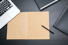 Overhead view of office table with blank notebook and pen, compu royalty free stock photos