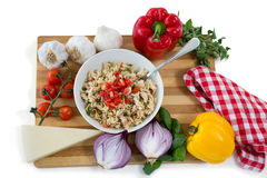 Overhead view of pasta served in bowl amidst vegetables on cutting board Stock Photography