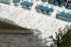Overhead View of Paved Walkway with Sidewalk Restaurant Furnishi Stock Photo