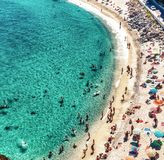 Overhead view of people at the beach, holiday concept in Tropea.  Stock Photo