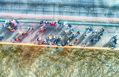 Overhead view of people walking over a bridge.  Royalty Free Stock Photography