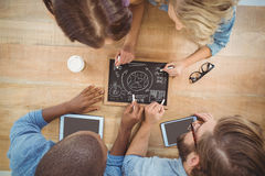 Overhead view of people writing business terms on slate Royalty Free Stock Photography