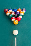 Overhead view of pool billards snooker balls on green table. Ready to break Stock Photography