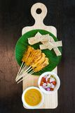 Overhead view pork satay with delicious peanut sauce, onion and Royalty Free Stock Photo