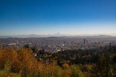 An overhead view of Portland Oregon on a fall day. The city of Portland Oregon sits under the watchful eye of Mt. Hood in the background on a slightly but Stock Photography