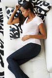 Overhead View Of Pregnant Woman Sleeping On Sofa Stock Photos
