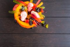OVerhead view of pumpkin with Halloween candies. Flat lay with copy space on wooden table stock photography