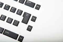 Overhead view of a Qwerty computer keyboard. Overhead view of a Qwerty alphanumeric computer keyboard with black keys on silver gradient to white with copy space stock photos