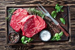 Overhead view of raw beef steaks, top view stock images