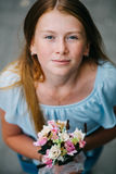 Overhead view of redhair girl holding bouquet of flowers and smiling at the camera royalty free stock photography