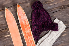Overhead view of retro ski accessories placed on old rustic wood Stock Photo