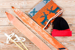 Overhead view of retro ski accessories placed on old rustic wood Royalty Free Stock Image