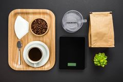 Overhead View Of Roasted Beans With Coffee Cup In Tray. On gray background royalty free stock photos