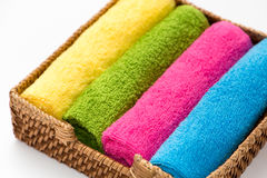 Overhead view of rolled, colorful towels in a basket Royalty Free Stock Images